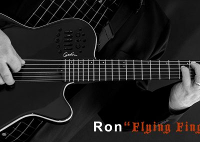 Ron Steta Home Page Header Image with his black Godin and Flying Fingers